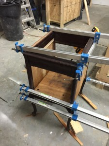 one of the ways we repair wood furniture using clamps and levels
