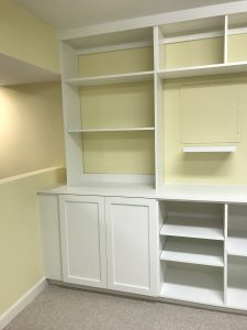 left side of white wall cabinets