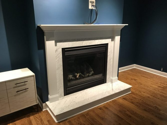 custom designed mantle above fireplace